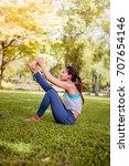 asian woman practicing yoga in... | Shutterstock . vector #707654146