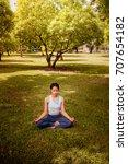 asian woman practicing yoga in... | Shutterstock . vector #707654182