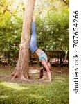 asian woman practicing yoga in... | Shutterstock . vector #707654266