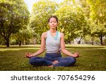 asian woman practicing yoga in... | Shutterstock . vector #707654296