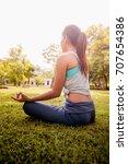 asian woman practicing yoga in... | Shutterstock . vector #707654386