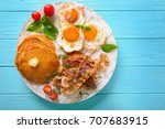 tasty breakfast with fried eggs ... | Shutterstock . vector #707683915
