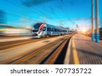 high speed train in motion at... | Shutterstock . vector #707735722
