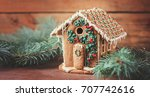 Gingerbread House On A Wooden...