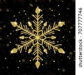 golden shiny snowflake on black ... | Shutterstock .eps vector #707777746