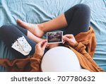 pregnant woman holding... | Shutterstock . vector #707780632
