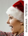 Small photo of Xmas, seasonal clothing, winter christmas concept. Happy woman wearing windblown Santa Claus helper hat