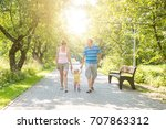 a baby boy walks by the handle... | Shutterstock . vector #707863312