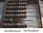 old wooden abacus laying on the ... | Shutterstock . vector #707952895