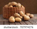 potatoes on a dark background.... | Shutterstock . vector #707974276