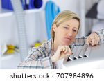 Small photo of repairwoman fixing machinery at construction site