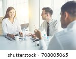 the three business people talk... | Shutterstock . vector #708005065