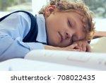 tired schoolboy sleeping in... | Shutterstock . vector #708022435