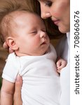 mom and baby are two months old | Shutterstock . vector #708060676