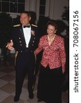 Small photo of Washington, DC. USA. 18th October, 1990 Chairman of the Joint Chiefs of Staff General Colin Powell (USA) along with his wife Alma arrive at the White House to attend a White House State Dinner
