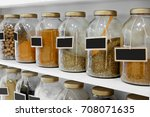 Different Spices In Jars On...