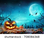 Stock photo pumpkin glowing at moonlight in the spooky forest halloween scene 708086368