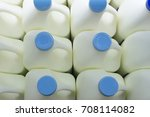 Small photo of On top of Several 5 liter of Cool Milk with Blue Caps