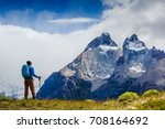 traveler with backpack hiking... | Shutterstock . vector #708164692