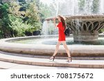young stylish woman wearing red ... | Shutterstock . vector #708175672