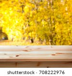 empty wooden table with autumn...   Shutterstock . vector #708222976