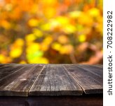 empty wooden table with autumn... | Shutterstock . vector #708222982