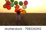 girl walking in a field with... | Shutterstock . vector #708226342