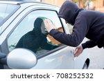 thief looking inside a car... | Shutterstock . vector #708252532