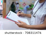 doctor who holds medical chart...   Shutterstock . vector #708311476