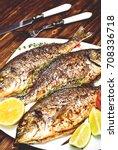 baked dorado   dorada fish on... | Shutterstock . vector #708336718