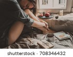 cozy home. woman with cup of... | Shutterstock . vector #708346432