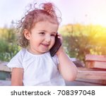 a child with curly hair is... | Shutterstock . vector #708397048