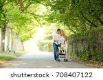 mother  father and baby in a... | Shutterstock . vector #708407122