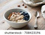 oatmeal porridge with... | Shutterstock . vector #708423196