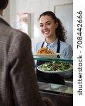 vigorous female worker serving... | Shutterstock . vector #708442666
