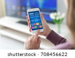 female hands holding phone with ... | Shutterstock . vector #708456622