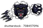 Stock photo a black panther angry animal sports mascot breaking through the background with its claws 708457096