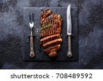 sliced grilled meat barbecue... | Shutterstock . vector #708489592
