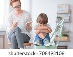 worried autistic boy sitting... | Shutterstock . vector #708493108