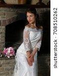 gorgeous brunette bride posing... | Shutterstock . vector #708510262