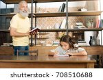 joyful grandfather dictating... | Shutterstock . vector #708510688