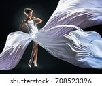 Slim Woman In Fluttering White...