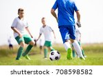 young boys playing football... | Shutterstock . vector #708598582