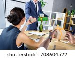 cropped shot of businessman... | Shutterstock . vector #708604522