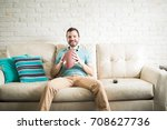 young man holding an american... | Shutterstock . vector #708627736