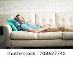 hispanic man on his 30s lying... | Shutterstock . vector #708627742