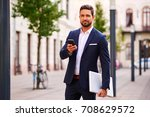 a handsome young businessman... | Shutterstock . vector #708629572