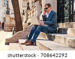 a middle age businessman siting ... | Shutterstock . vector #708642292