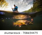 fishing. fisherman and trout ... | Shutterstock . vector #708654475