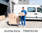 delivery man with box and cart... | Shutterstock . vector #708656146